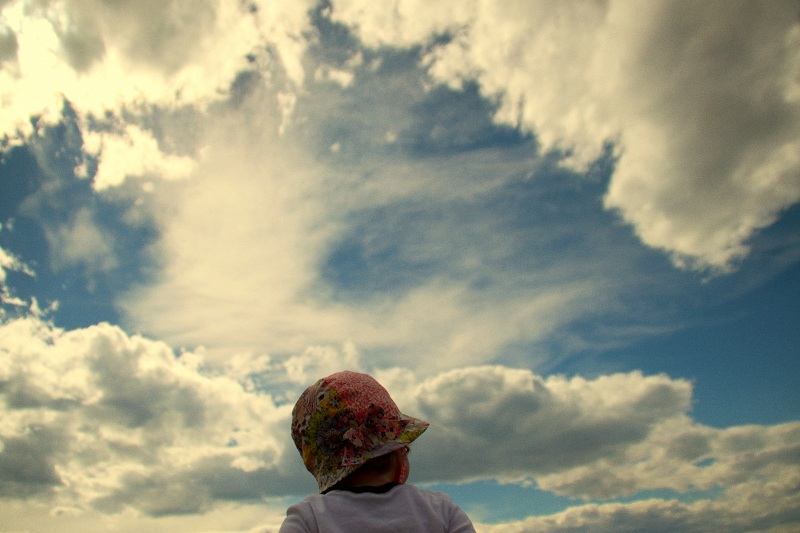 Child looking at clouds
