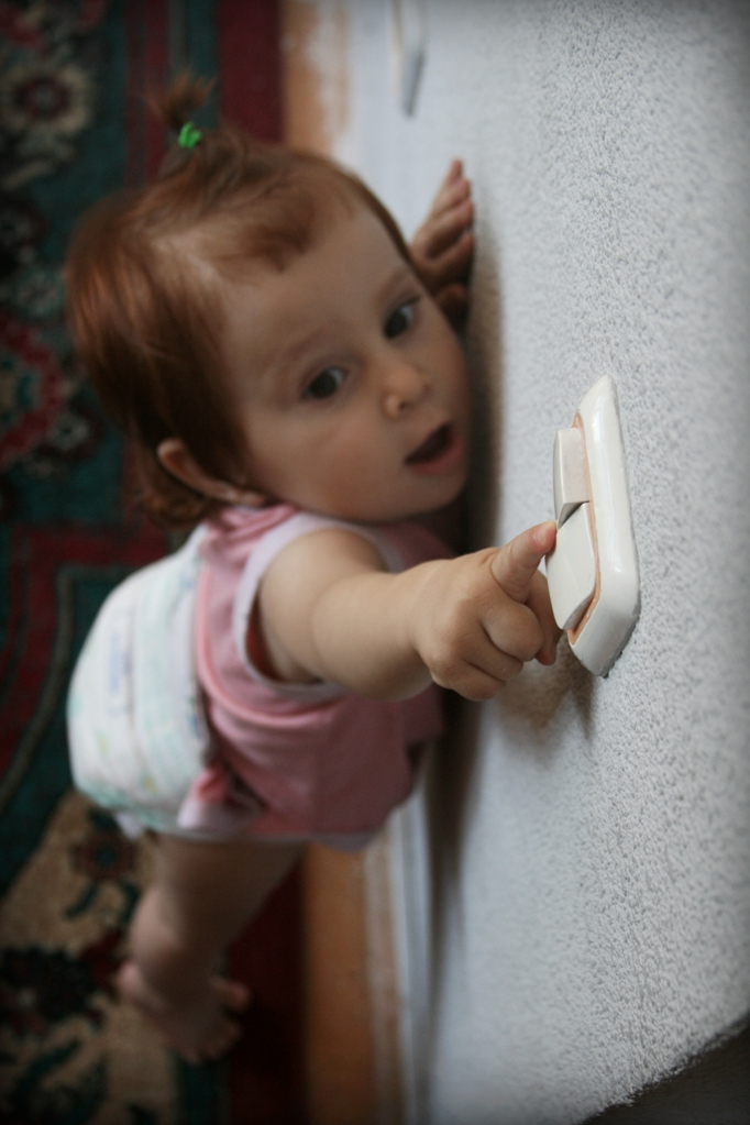 Toddler reaching for light switch