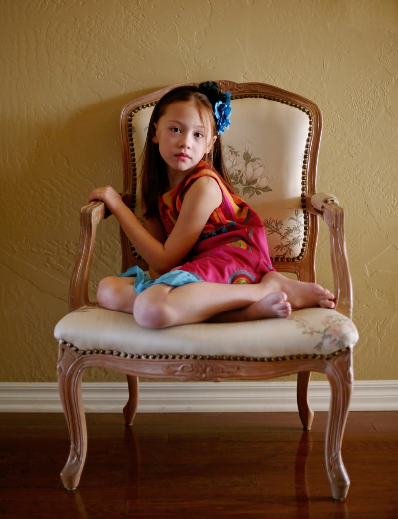 Girl sitting in a chair