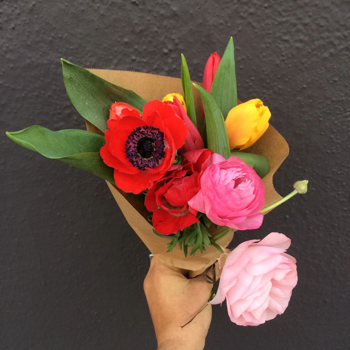 Raunculus and tulips in hipster bridal bouquet