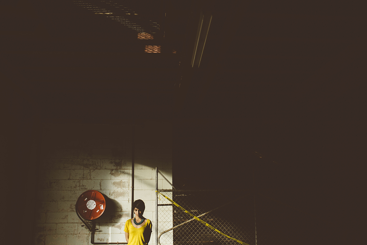 Woman in industrial warehouse